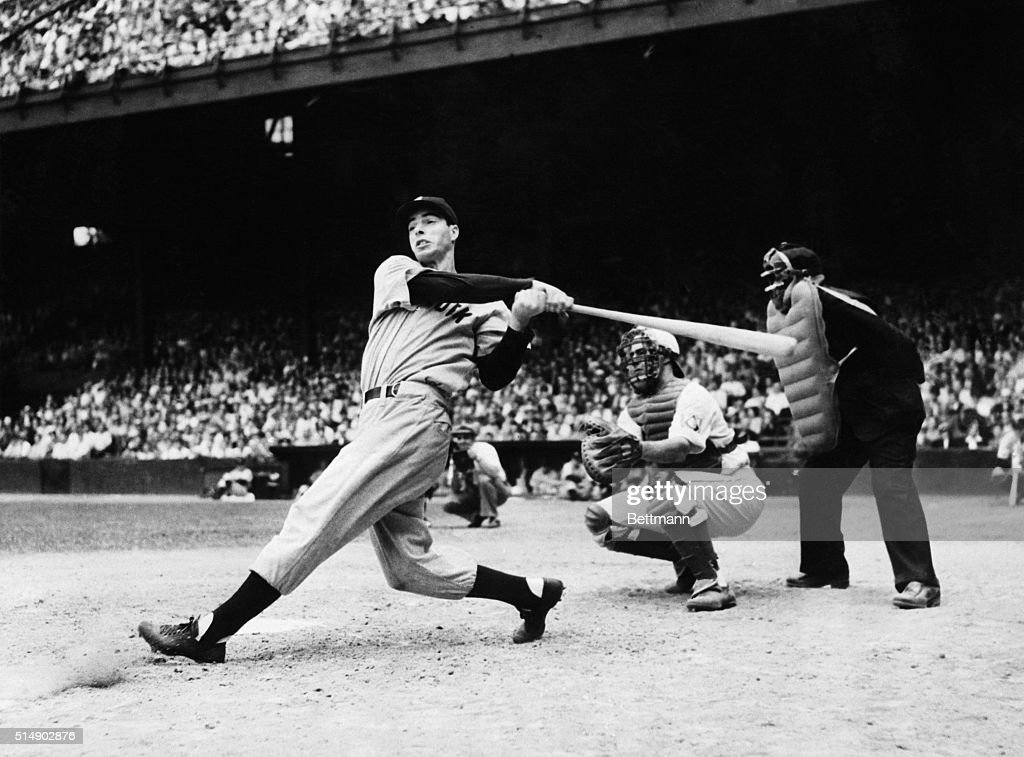 <a gi-track='captionPersonalityLinkClicked' href=/galleries/search?phrase=Joe+DiMaggio&family=editorial&specificpeople=93596 ng-click='$event.stopPropagation()'>Joe DiMaggio</a> is pictured as he smashed out his second homer in the first game of the Yankees double header with the Philadelphia Athletics. Joe and the other Yankee sluggers made baseball history when they clouted out eight four-baggers in the first game and five in the second game, breaking all existing hom run records. Hayes is catching. Acme photograph.