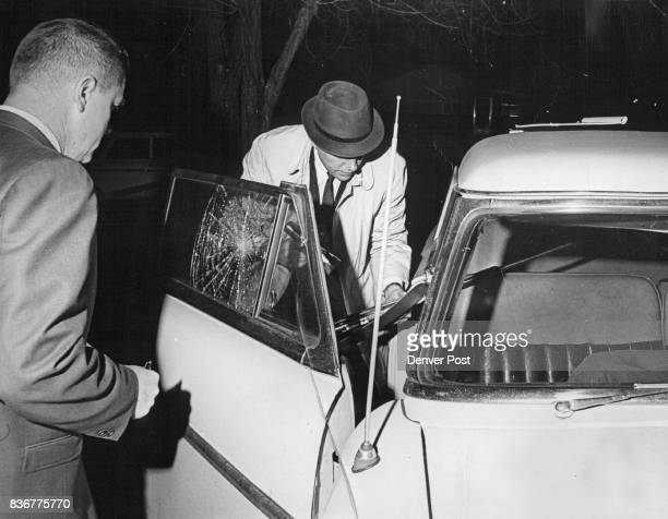 Shooting Death Termed Suicide Frank Zalesny left coroner's assistant and Detective Joe Gross remove a Russian made 7 62caliber rifle from the car in...