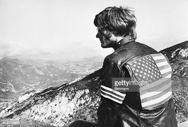6/30/1969Peter Fonda in a scene from the movie 'Easy Rider' He is shown with his back to the camera wearing a jacket with the American flag on it