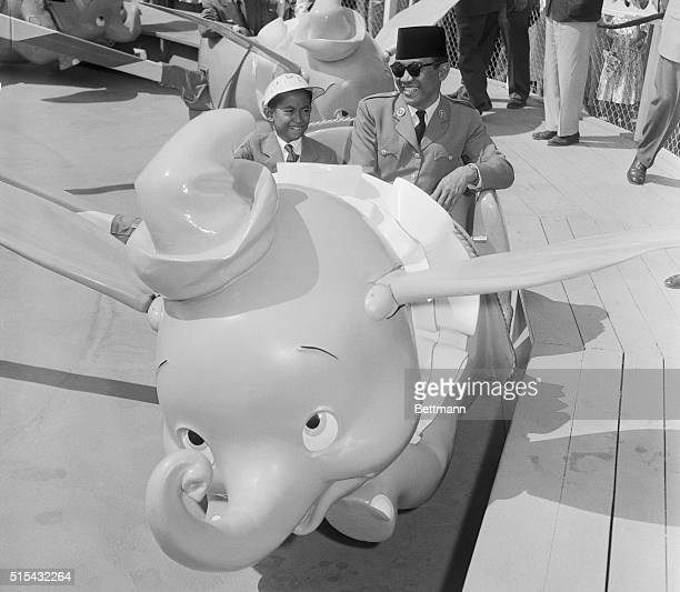 6/4/1956Anaheim California Dr Achmed Sukarno President of Indonesia now touring the US is shown with his son Guntur riding behind 'Dumbo' one of the...
