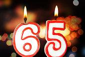 Birthday candles celebrating 65th birthday