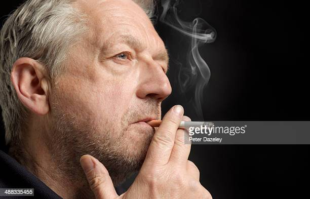 65-year old man smoking
