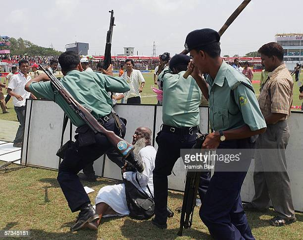 65yearold photographer Zahirul Haq is set upon by police during the lunch break as the media protest the earlier beating of photographer Shamsul...