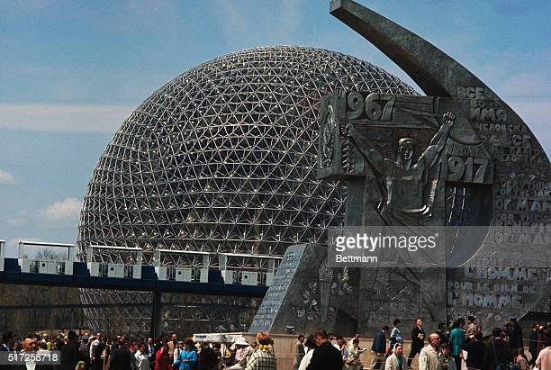 View of United States Pavilion In foreground is Hammer and Sickel sculpture symbol of Communist Russia