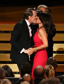 66th ANNUAL PRIMETIME EMMY AWARDS Pictured Actor Bryan Cranston and actress Julia LouisDreyfus kiss on stage during the 66th Annual Primetime Emmy...