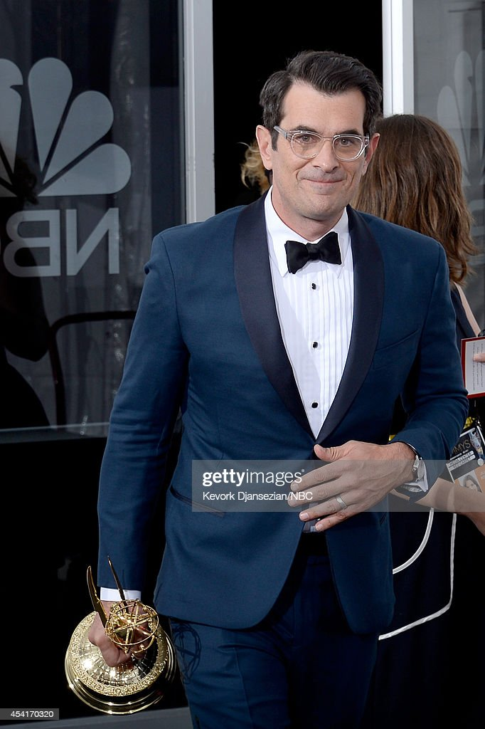 66th ANNUAL PRIMETIME EMMY AWARDS Pictured Actor Ty Burrell winner of Outstanding Supporting Actor In A Comedy Series for 'Modern Family' poses in...