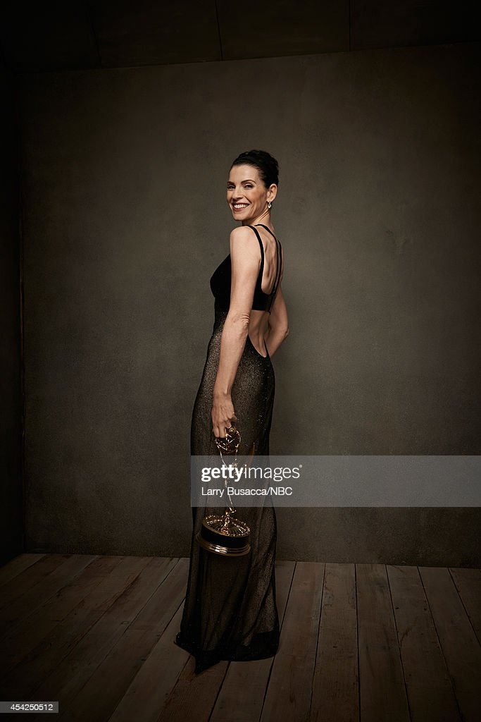 66th ANNUAL PRIMETIME EMMY AWARDS Pictured Actress Julianna Margulies from 'The Good Wife' poses in the NBC/People photo booth during the 66th Annual...