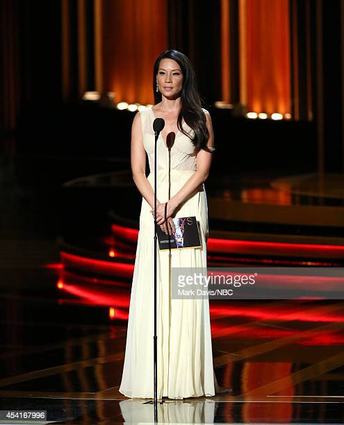 66th ANNUAL PRIMETIME EMMY AWARDS Pictured Actress Lucy Liu speaks on stage during the 66th Annual Primetime Emmy Awards held at the Nokia Theater on...
