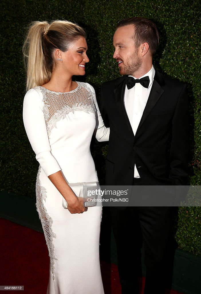 66th ANNUAL PRIMETIME EMMY AWARDS Pictured Director/actress Lauren Parsekian and actor Aaron Paul arrive to the 66th Annual Primetime Emmy Awards...