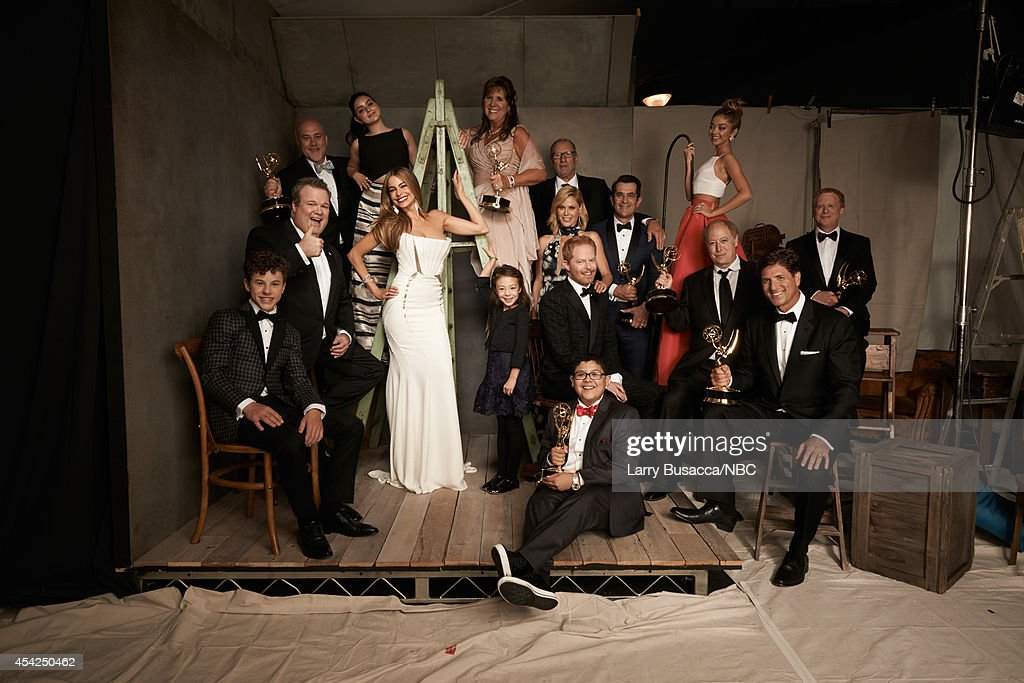 66th ANNUAL PRIMETIME EMMY AWARDS Pictured 'Modern Family' cast and crew Nolan Gould Eric Stonestreet Ariel Winter Sofia Vergara Aubrey...