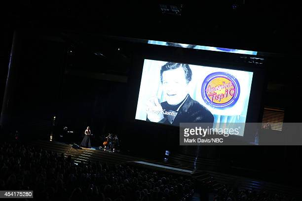 66th ANNUAL PRIMETIME EMMY AWARDS Pictured Recording artist Sara Bareilles performs on stage while an image of late TV personality/voice actor Casey...