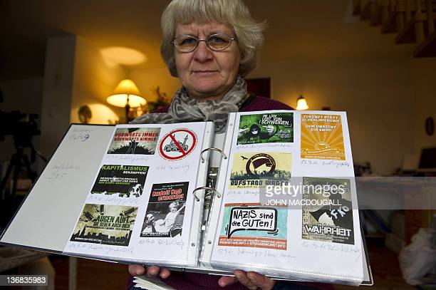 COLE 66yearold antiNazi activist Irmela MensahSchramm displays a scrap book containing far right and Nazi stickers she has removed from public places...