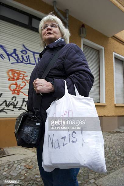 COLE 66yearold antiNazi activist Irmela MensahSchramm sports a bag inscribed with the words 'Against Nazis' as she does her round in eastern Berlin's...