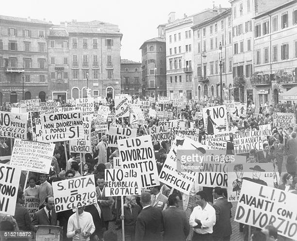 6/7/1969Rome Italy About 3000 demonstrators hold placards in the famous Piazza Navona during a demonstration in favor of divorce The placards read...