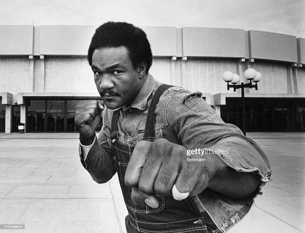 Heavyweight contender George Foreman strikes a fighting pose in front of Nassau Coliseum here where he meets Joe Frazier in a 12-round bout.