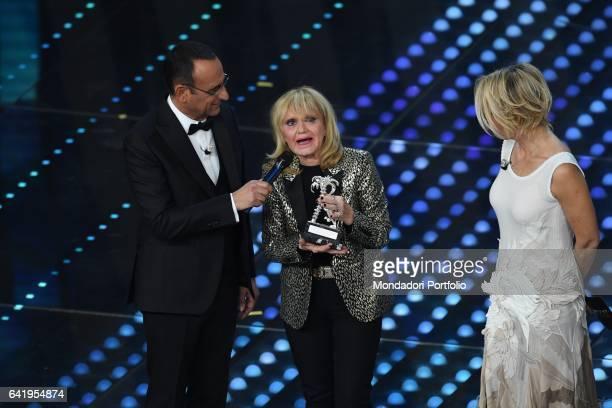 67th Sanremo Music Festival 5th night Sanremo February 11 2017 In the picture Singer Rita Pavone Tv hosts Carlo Conti and Maria De Filippi