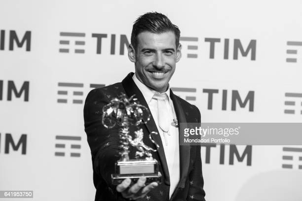 67th Sanremo Music Festival 5th night Winner Francesco Gabbani with his prize during the photo call after show Sanremo February 11 2017