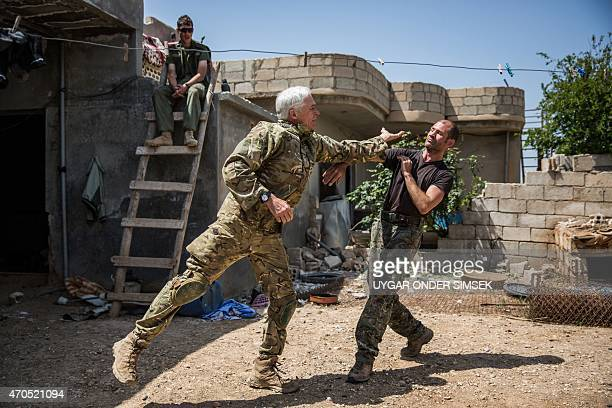 A 67year old man from Canada and a 40year old from the UK nicknamed by Kurdish fighters as Hewal Zinar and Hewal Cudi train on April 19 in the...