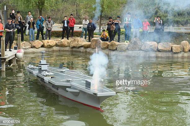 A 6meterlong and 80centimeterwide scale model aircraft carrier weighing more than 700 kilograms fires a miniature missile as it is tested in water on...
