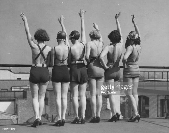 Roof top bathing belles showing off the low back style of their costumes Vogue 1933