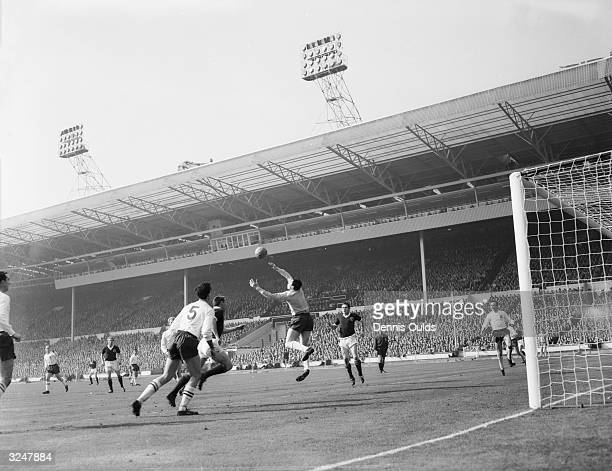 England goalkeeper Gordon Banks and centrehalf Maurice Norman beat off an attack by Scotland centreforward Ian St John during the soccer...