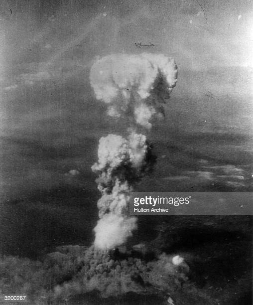 Aerial view of a mushroom cloud from an atomic blast rising over Hiroshima Japan