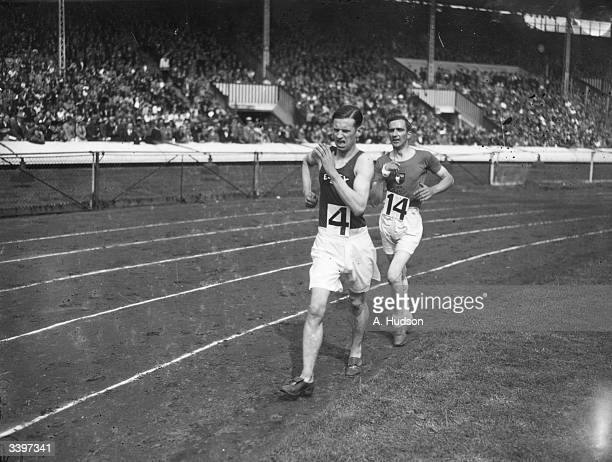 A A Cooper passing H G Churcher from Belgrave Harriers during the 2 mile walk at the Annual British Games InterCounty Athletics Championship at the...