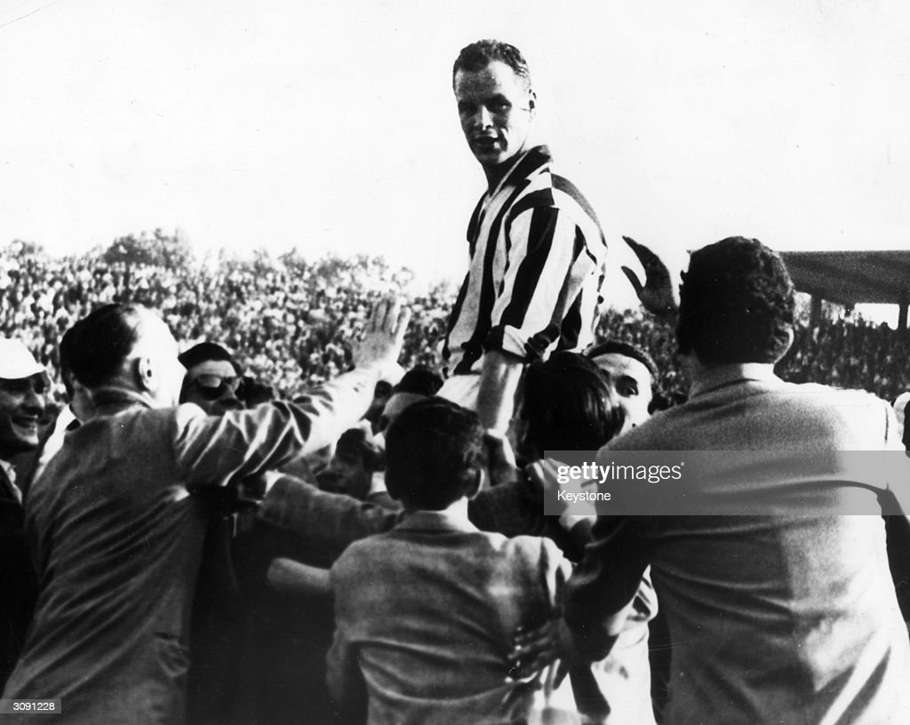 Welsh footballer John Charles is held aloft by supporters after he led his team Juventus to victory in the Italian Cup at Turin.