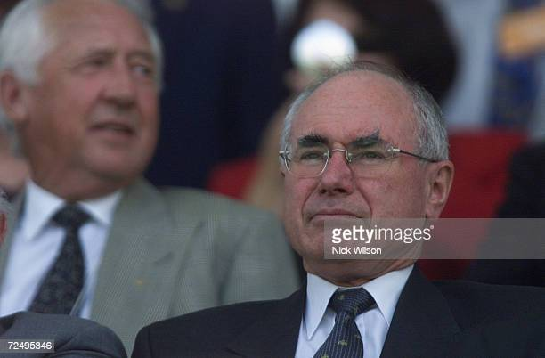 The Prime Minister of Australia John Howard watches from the grandstand during the Prime Ministers XI v New Zealand being played at Manuka Oval...