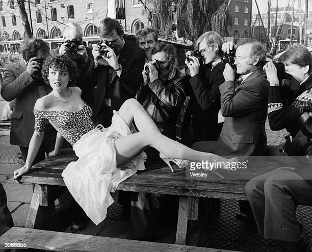 'Page 3' girl Karen Richerdson posing for finalists in a competition run by Amateur Photographer Magazine outside the Dickens Inn St Katharine's Dock...