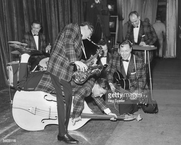 Bill Haley and his Comets get a little carried away during rehearsals for their first London show at the Dominion Theatre