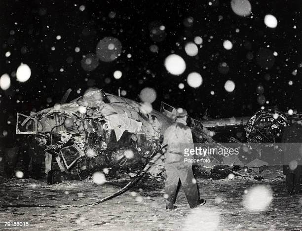 Rescue workers with wreckage of the BEA Elizabethan airliner GALZU 'Lord Burghley' after the crash at Munich in which 23 people died including 8...