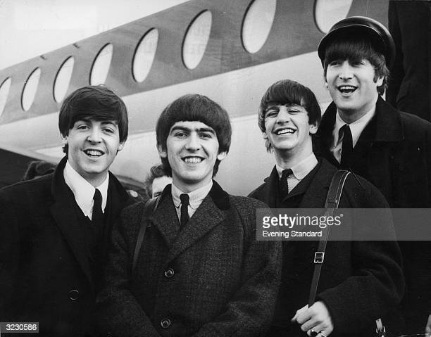 The Beatles arriving at London Airport after a trip to Paris From left to right Paul McCartney George Harrison Ringo Starr and John Lennon