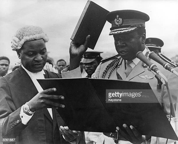 MajorGeneral Idi Amin Ugandan soldier dictactor and head of state takes the Oath of Office at the colourful ceremony in Kampala when the new...