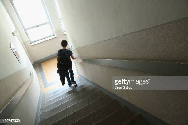 A 6th grade pupil walks down a stairwell at the Middle School on May 14 2014 in Seifhennersdorf Germany The state of Saxony officially closed the...