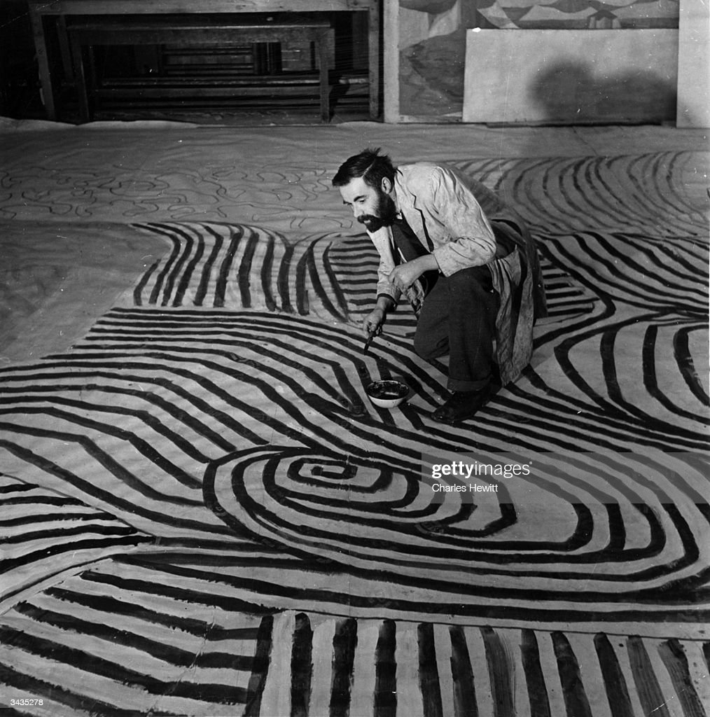 British artist Victor Pasmore (1908 - 1998) at work in a restaurant on London's South Bank for the Festival of Britain. Original Publication: Picture Post - 5178 - The Festival Is Britain's - pub. 1951