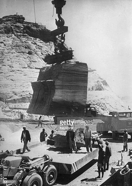 A large stone block from the great temple at Abu Simbel being hoisted on to a transporter as part of the UNESCO initiative to move the temple and...