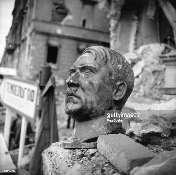A bust of Adolf Hitler lies amidst the ruins of the Chancellery Berlin