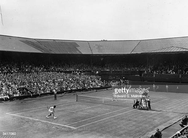 Dick Savitt of the USA in action on the Centre Court against Australia's Ken McGregor during the men's singles final at the Wimbledon Lawn Tennis...