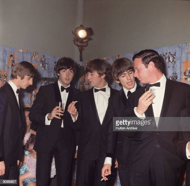 George Harrison John Lennon Paul McCartney and Ringo Starr of the Liverpudlian pop group The Beatles with their manager Brian Epstein at the premiere...