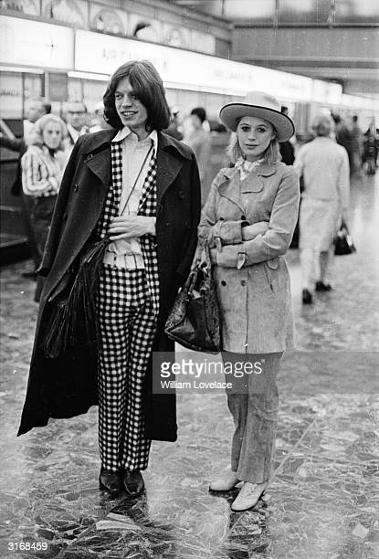 Singer Marianne Faithfull and Mick Jagger of the Rolling Stones at London Airport