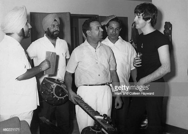Paul McCartney from The Beatles is given a sitar demonstration in Rikhi Ram's instrument shop in New Delhi India on 6th July 1966
