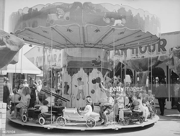Children enjoying a ride on a merrygoround at Butlin's amusement park Skegness Lincolnshire