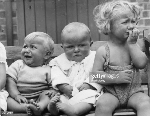 Contestants in a baby show at Greenford Middlesex are not very happy