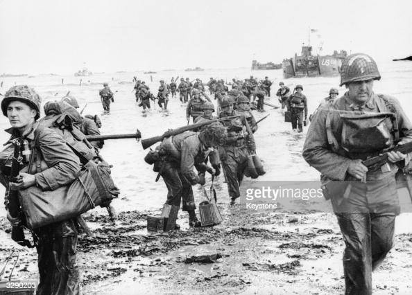 US Assault Troops seen here landing on Omaha beach during the Invasion of Normandy