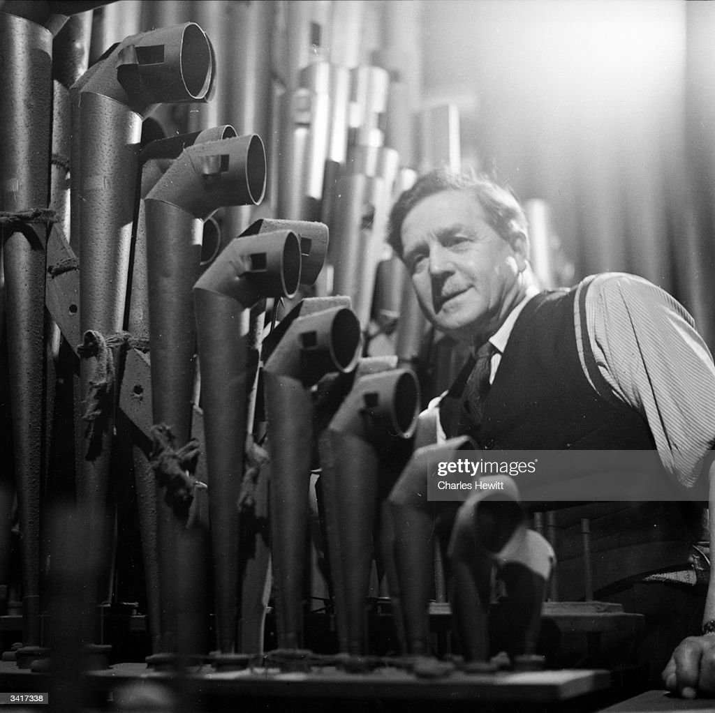 The organ pipes, at Westminster Abbey, London, being cleaned in preparation for the coronation ceremony. Original Publication: Picture Post - 6534 - How Will You Spend The Day? - pub. 1953