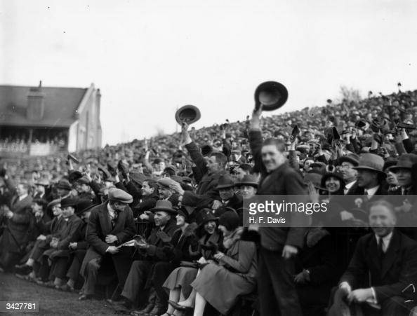 A huge crowd of happy supporters at Craven Cottage London for a Fulham versus Manchester United football match in the sixth round of the FA Cup
