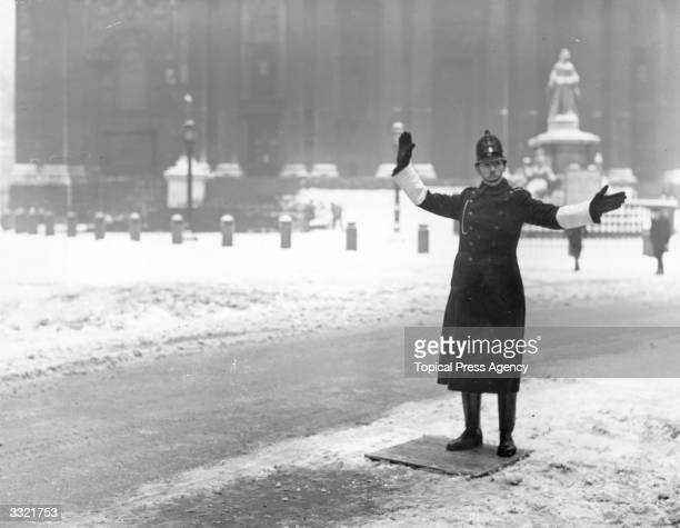 A London policeman on traffic duty at St Paul's Cathedral after a night of heavy snow
