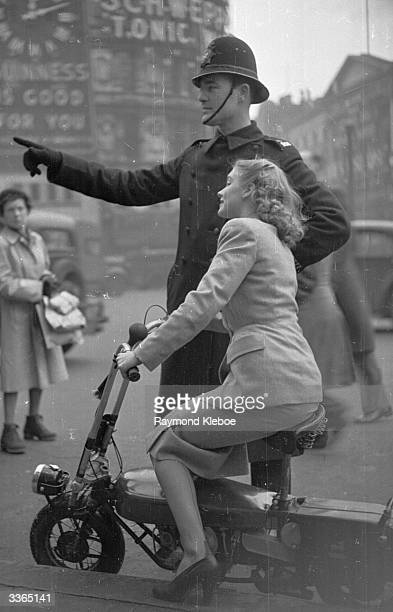 Asking a policeman for directions Rank starlet Susan Shaw on a Corgi scooter It has a 98cc twostroke engine weighs 95 lbs does 120mpg and 30 mph...