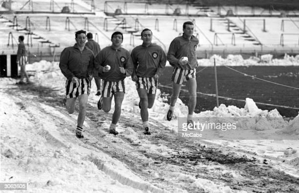 Chelsea footballers Johnny Boyle Terry Venables Ron Harris and Eddie McCreadie training at Stamford Bridge